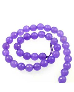 These Jade beads have been dyed a violet colour. Sold as temporary strung 37cm (approx) strands.