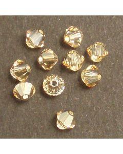 Swarovski® 4mm Golden Shadow Bicone Xilion Cut Beads (Pack of 10)
