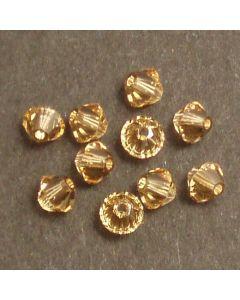 Swarovski® 4mm Light Colorado Topaz Bicone Xilion Cut Beads (Pack of 10)